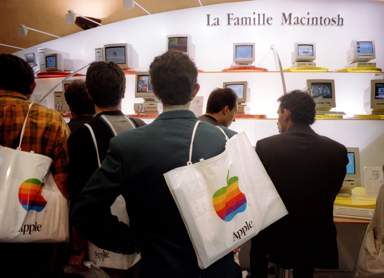 People attend the annual Apple Expo at the CNIT center at La Defense in Paris September 15. Apple p..